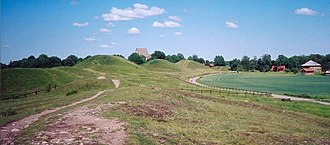 Tumulus - The Royal mounds of Gamla Uppsala in Sweden from the 5th and 6th centuries; Originally the site had 2,000 to 3,000 tumuli; due to quarrying and agriculture only 250 remain.