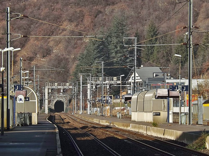 Sight of the platforms and tracks of Moûtiers railway station in the Tarentaise valley of Savoie (France), in the direction of Chambéry, Lyon and Paris with visible the tunnel des Esserts tunnel.