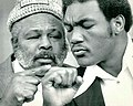George Foreman and Archie Moore 1973.jpg