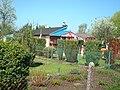 Gniazdo z bocianami na altance - wiosna 2011r. - panoramio.jpg