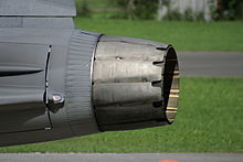 Side-view of circular aircraft engine exhaust nozzle, showing two distinct layers