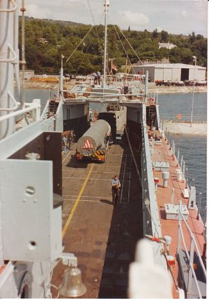 Mark 8 Landing Craft Tank - A Polaris missile being unloaded from the tank deck of HMAV Abbeville in 1977