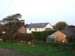 Halsall railway station - The site of Halsall railway station in 2007. The white house in the centre, now a private residence, is the old station building. The track ran parallel to the edge of the field