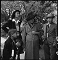 Hayward, California. This family is awaiting evacuation bus. Each person carries an identification . . - NARA - 537502.jpg