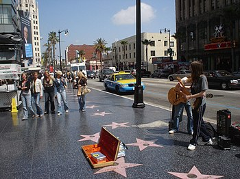 English: A band plays on the Hollywood Walk of...