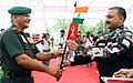 Indian Army Motorcycle Expedition Team Leader Lt. Col. V.K.S. Tomar handing over the Expedition Baton to the Chief of Army Staff, Gen. VK Singh, during the flagging in ceremony, at India Gate, in New Delhi.jpg
