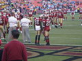Isaac Bruce & Frank Gore on field pregame 8-29-08 1.JPG