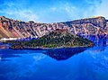 Island on Blue Water Surrounded by Mountain.jpg