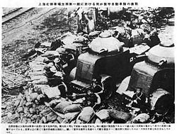 Japanese armored car unit at the front line near Shanghai North Railway Station.jpg