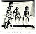 Japanese nurse with dependent children having typical appearance of malnutrition, New Bilibid Prison, September-October 1945.jpg