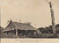 KITLV - 173525 - Demmeni, J. - Kubu (guesthouse) with defense statue on the road to Tanah Putih in Borneo - 1890-1904.tiff