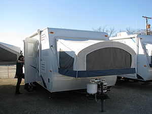 A hybrid travel trailer made by KZ Recreationa...