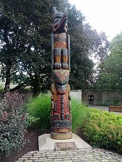 Totem spirit being, sacred object, or symbol that serves as an emblem of a group of people, such as a family, clan, lineage, or tribe
