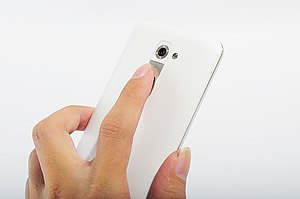 LG G2 - The G2's volume and power keys are positioned on the rear, where the index finger would lie when holding the phone.