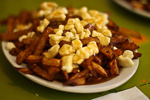 Cuisine of Quebec - A Classic poutine, such as this one from La Banquise, is made with french fries, cheese curds and gravy.