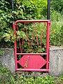 La Rixouse - Petit portail rouge (juil 2018).jpg