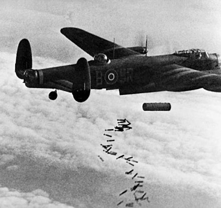"A Lancaster releases the main part of its load, a 4,000 lb (1,800 kg) HC ""cookie"" and 108 30 lb (14 kg) ""J"" incendiaries. (over Duisburg 1944) Lancaster I NG128 Dropping Blockbuster - Duisburg - Oct 14, 1944.jpg"