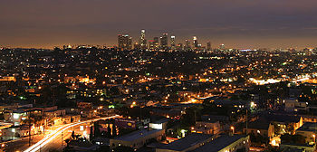 Los Angeles at night, with a brightly illuminated sky.