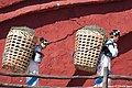 Lijiang Yunnan China-Naxi-people-carrying-baskets-01a.jpg