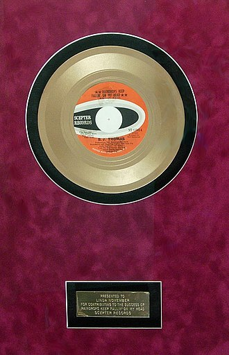 """Linda November - Gold record presented to Linda November for her work as a backup singer on the 1969 song """"Raindrops Keep Fallin' on My Head"""""""