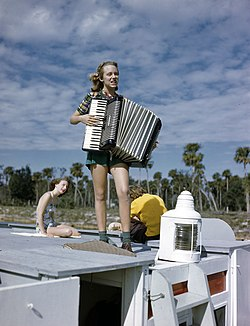 Lois Duncan Steinmetz playing the accordion aboard the shantyboat Lazy Bones.jpg