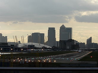 Canary Wharf - London City Airport runway with Canary Wharf and the O2 Arena in the background.