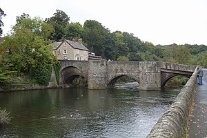 Ludford, Shropshire - Viewed from downstream and the Ludlow side, Ludford Bridge, which now takes the B4361 road across the River Teme. The large public house, the Charlton Arms, is just behind.