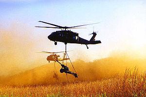 M119 howitzer - M119 slingloaded by UH-60 Blackhawk