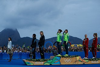 New Zealand at the 2016 Summer Olympics - 49erFX medal ceremony (l-r) Alex Maloney, Molly Meech (New Zealand); Martine Grael, Kahena Kunze (Brazil); Jena Mai Hansen, Katja Salskov-Iversen (Denmark)
