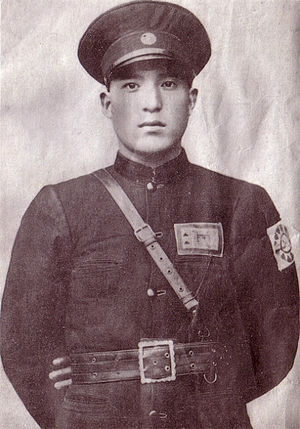 Ma Zhongying - Gen. Ma Zhongying, KMT 36th Division Chief. He is wearing a Kuomintang armband like many of his troops did.