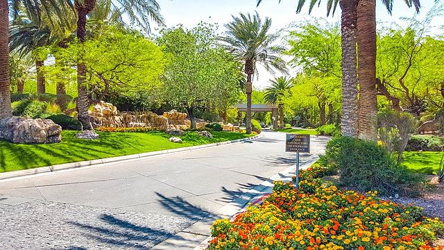 Affluent neighborhoods are located throughout the Las Vegas Valley. Above is the entrance to MacDonald Highlands.