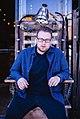 Magician Kyle Marlett sitting on electric chair.jpg