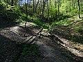 Malá Chuchle, potok a náhon rybníčku, propustek, pohled k prameni.jpg