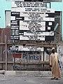 Man in Street with Construction Signage - Dar es Salaam - Tanzania (8814925684).jpg