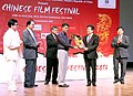 Manish Tewari presenting a memento to the Minister of State Administration for Press, Publication, Radio, Film & Television, Government of China, Mr. Cai Fuchao, at the inaugural ceremony of the Chinese Film Festival 2013.jpg