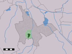 The town centre (dark green) and the statistical district (light green) of Vries in the municipality of Tynaarlo.