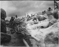 Marines take cover behind a sea wall on Red Beach ^3, Tarawa. - NARA - 532385.tif