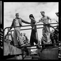 Marines unloading Japanese POW from a submarine returned from a war patrol. - NARA - 520838.tif