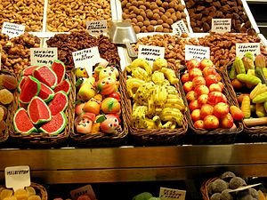 Marzipan - Fruit-shaped marzipan in baskets at a shop in Barcelona