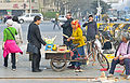 Melon on stick on sale outside Temple of Heaven, Beijing.jpg