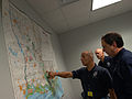 Michael Brown views map at Office of Emergency Management briefing.jpg