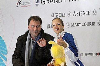 Carolina Kostner - Kostner with coach Michael Huth in 2010