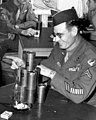 """Military Police drinking Schaefer (""""olive drab"""" colored cans made for military personnel use)l, from- M.P.s Stacking Beer Cans in Club Room 1946 Oak Ridge (23767395303) (cropped).jpg"""
