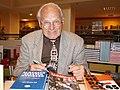 Miroslav Sígl se svými knihami.jpg