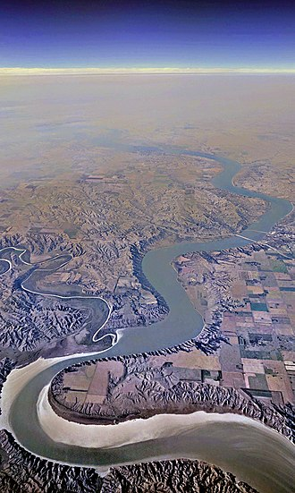 White River (Missouri River tributary) - Aerial view from the south of the Missouri River in South Dakota, where the much smaller White River flows into it from the west.  The Interstate 90 bridge is visible in the distance.