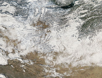 Geography of Mongolia - Snow covers Mongolia in patches in this image from December 21, 2003. Snowfall is normally light and blows away quickly during the winter, so to see this much snow on the ground at once is rather unusual.