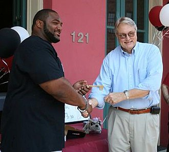 Montrae Holland - Holland (left) presented with the key to his hometown, Jefferson, Texas.