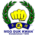 Moo Duk Kwan fist logo created by Hwang Kee in 1955.png