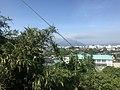 Mount Sakurajima from train near Wada Middle School in Kagoshima, Kagoshima.jpg