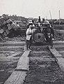 Moving A Log in Japan - Detail (1914 by Elstner Hilton).jpg
